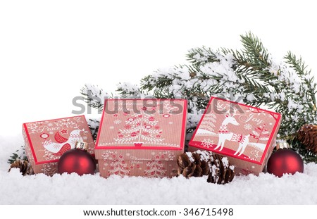 Holiday gift boxes on snow with a white background - stock photo