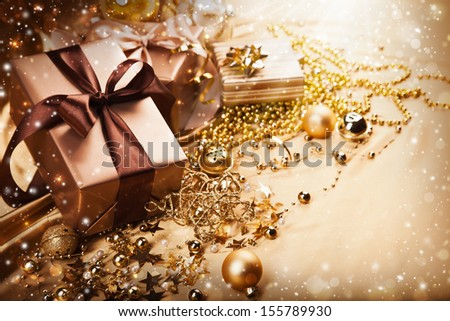 Holiday gifts and decorations on the magical background - stock photo