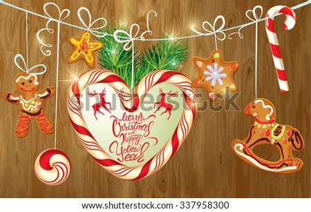 Holiday greeting Card with xmas gingerbread, candy and fir-tree branches. Hand written calligraphic text Merry Christmas and Happy New Year on wooden background.  Raster version - stock photo