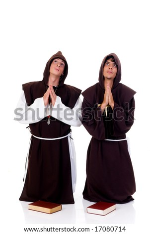Holiday Halloween scene, two priests in habit praying.  Studio, white background.