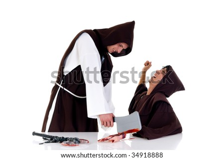 Holiday horror Halloween scene, two priests in habit, one chopping of hand of colleague.  Studio, white background.