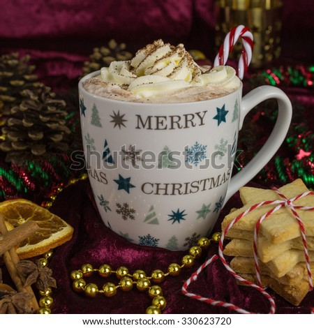 Holiday hot chocolate with whipped cream and christmas decoration