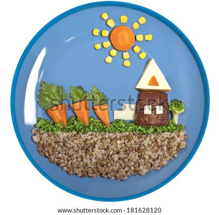 Holiday house. Children's meal from buckwheat and vegetables - stock photo