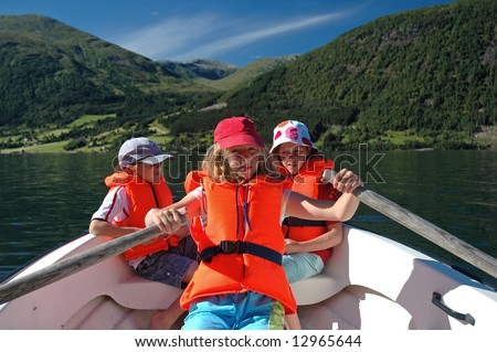 holiday image of children in row boat - stock photo