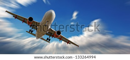 Holiday jet against beautiful blue sky - stock photo