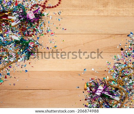 Holiday: New Year's Eve Confetti and Horn Background - stock photo