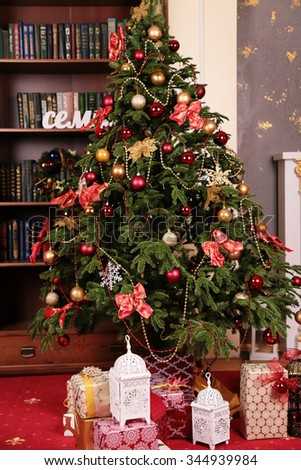 holiday photo of cozy home interior, with Christmas tree and New Year decoration