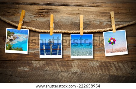 Holiday photos hanging on the clothesline - stock photo
