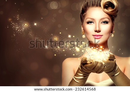Holiday Retro Woman with magic in her hand. Beauty Fashion Christmas Vintage Style Lady with Beautiful Luxury Hairstyle, makeup, accessories. Golden Silk Gloves and dress  - stock photo