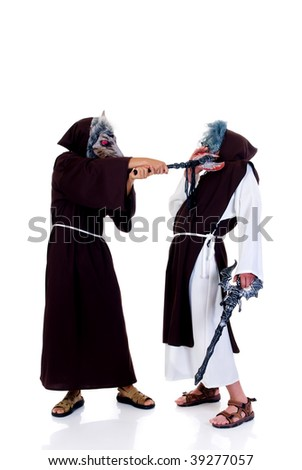 Holiday scene, two Halloween characters,  priests in habit fighting.  Studio, white background.