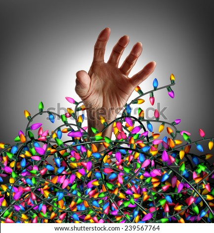 Holiday season stress concept as a human hand escaping from a chaotic tangled mess of three dimensional decoration lights as a symbol of seasonal distress and social anxiety. - stock photo