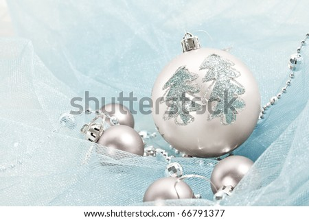 Holiday series: christmas silver ball with garland on blue cloth