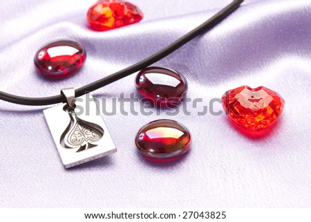 Holiday series: red glassy decoration and silver penedent for valentine day