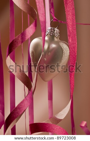 holiday series: some white christmas heart-shaped ball over light red background