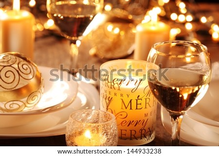 Holiday setting and decorations on table - stock photo