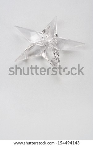 Holiday star on gray paper background.