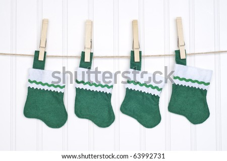 Holiday Stockings Hanging on a Clothesline on a White Background. - stock photo