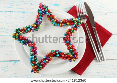 Holiday table setting on color wooden table background - stock photo