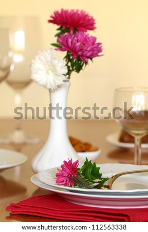 holiday table setting with flowers - stock photo
