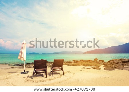 Holiday vacation, beach chairs on the beach, vacation time on the beach concepts, vintage tone, soft focus