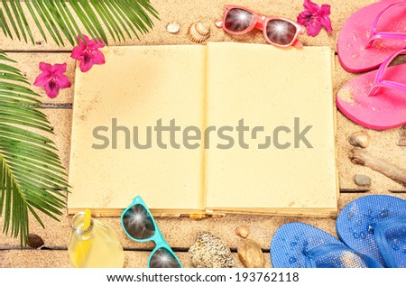 Holiday (vacation) tropical beach background layout with blank open book and free text space. Palm tree leaves, exotic flowers, sunglasses and flip flops on sand. - stock photo