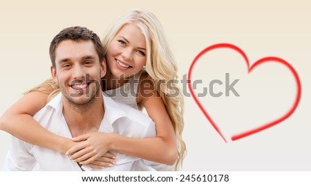 holiday, valentine's day, dating and love concept - happy couple having fun over beige background and red heart shape - stock photo