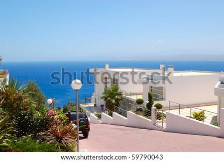 Holiday villas at resort, Crete, Greece - stock photo