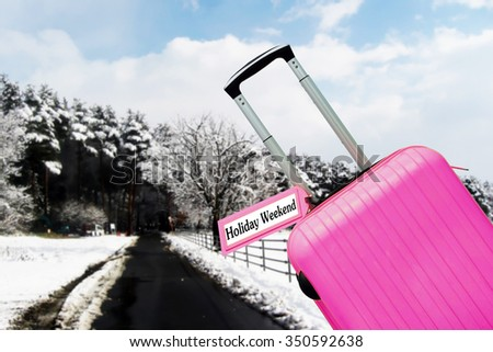 Holiday weekend. suitcase with label at sea. - stock photo