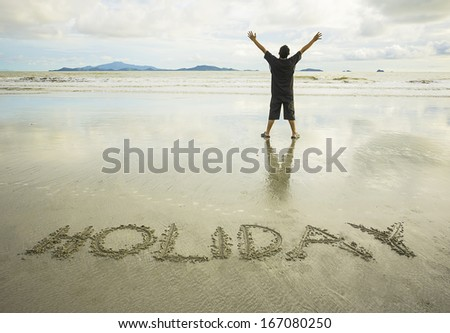 Holiday word written on sand - holiday concept