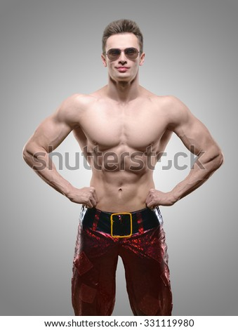 Holidays and celebrations, New year, Christmas, sports, bodybuilding, healthy lifestyle - Muscular handsome sexy Santa Claus