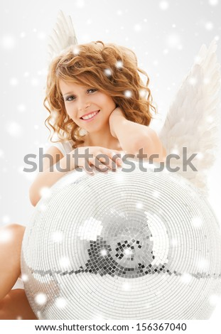 holidays and costumes concept - happy teenage angel girl with disco ball - stock photo