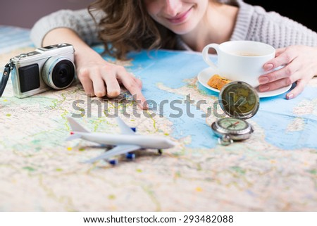 holidays and tourism concept. Coffee break for the dream of travel. Shallow depth of field - stock photo