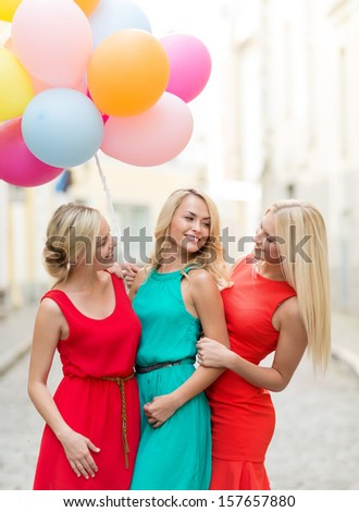 holidays and tourism, friends, hen party, blonde girls concept - three beautiful women with colorful balloons in the city - stock photo