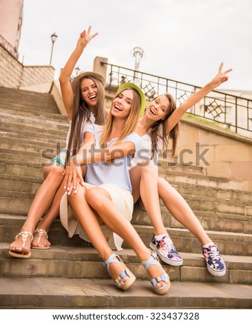 Holidays and tourism, friends, hen party, three beautiful women in the city - stock photo