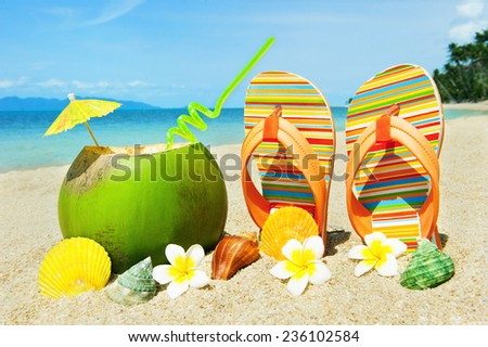 Holidays background. Beautifuk beach with palms and coctail - stock photo