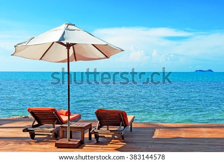 Holidays Background. Chairs on the beach near sea - stock photo
