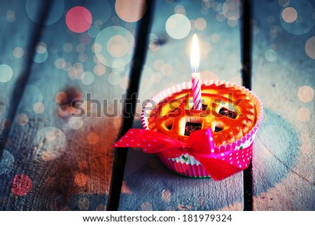 Holidays background with Sweet Cupcake ,bokeh and candle - stock photo