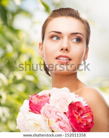 holidays, beauty and jewelry - woman with diamond earrings and flowers - stock photo