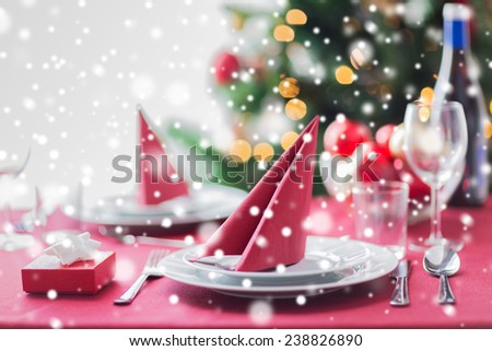 holidays, celebration and home concept - close up of room with christmas tree and decorated table - stock photo