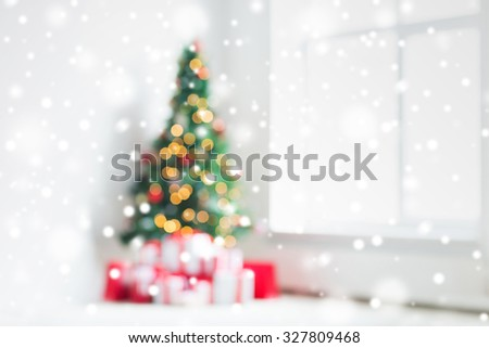 holidays, celebration and home concept - living room with christmas tree and presents background - stock photo