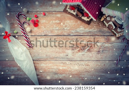 holidays, christmas, baking and sweets concept - closeup of beautiful gingerbread houses at home - stock photo