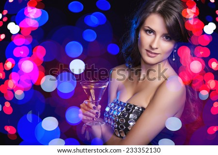 Holidays, christmas, people celebration concept. Closeup of woman in evening dress with glass over holidays lights bokeh background - stock photo