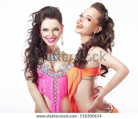 Holidays. Couple of Happy Entertainers in Stagy Costumes Laughing - stock photo