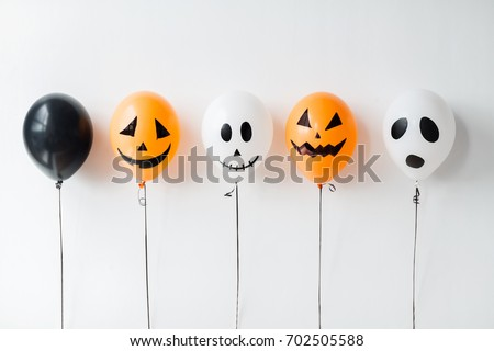 holidays, decoration and party concept - scary air balloons for halloween over white background