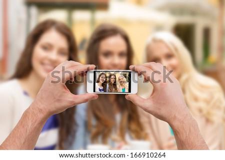 holidays, electronics and tourism concept - close up of man hands taking picture with smartphone camera