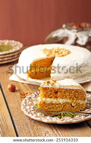 Holidays, food and drink concept. Carrot cake with spices on a wooden table. Selective focus - stock photo