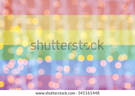 holidays, gay pride, homosexuality and tolerance concept - blurred golden lights over rainbow flag background - stock photo