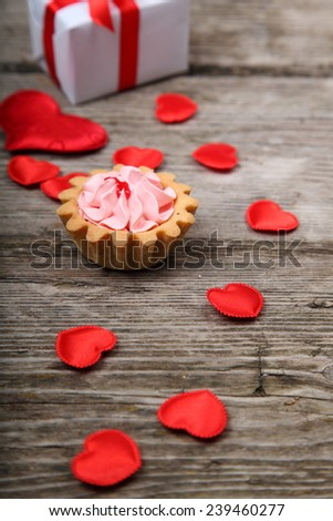 Holidays gift,cake and red heart on wooden background. Valentines day background.