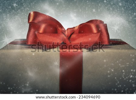 Holidays gift concept. Magical red ribbon gift box. - stock photo