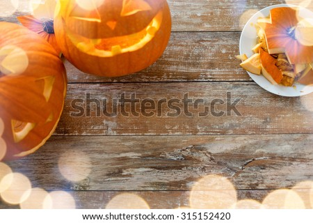 holidays, halloween and decoration concept - close up of pumpkins on table - stock photo